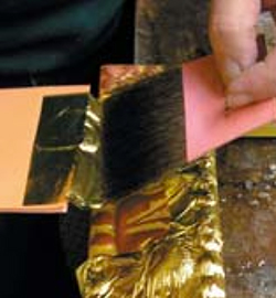 The frame is then carefully water gilded with 22K gold.